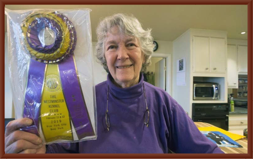 Julie Shows off Bernie's Westminster Best of Breed  Ribbon